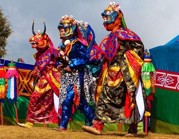 Drei Maskierte Tänzer in Bhutan